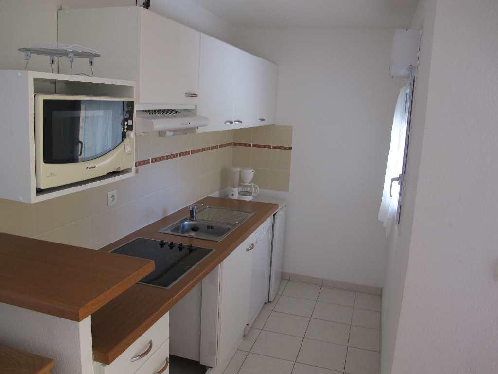 IMMOPLAGE VALRAS-PLAGE, agence immobilière, vente, location et location vacances appartement et maison entre Agde/Sete et Narbonne, proche Béziers - Appartement en rez-de-jardin - VALRAS PLAGE - Vente - 45m²